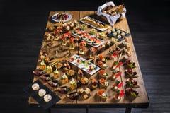 Snacks set. Brushettas, canapes, salads, desserts, tartlets, oys Stock Images
