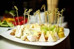 Snacks on skewers. Different tasty snacks on skewers Stock Image