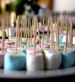 Marshmallows crossed with chopsticks stock photos