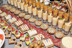 Snacks and sweets on banquet table Royalty Free Stock Photos