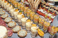 Snacks and sweets on banquet table Royalty Free Stock Images
