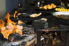Snacks and sweets being cooked at a store, Pushkar, stock photos