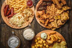 Snacks to beer on wooden background top view Royalty Free Stock Photo