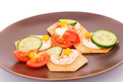 Snacks with vegetables. And cheese cream on brown plate Stock Photography