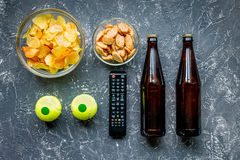 Snacks for watching sport match on dark background top view Royalty Free Stock Images