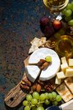 snacks, wine and camembert and dark background, vertical Royalty Free Stock Photography