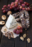 Snacks for wine, cheese with mold, pink grapes, walnuts Stock Images