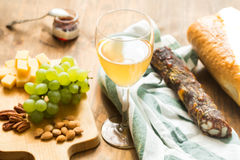 Snacks for wine: grapes, cheese, nuts Stock Images
