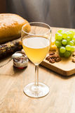 Snacks for wine: grapes, cheese, nuts Royalty Free Stock Image