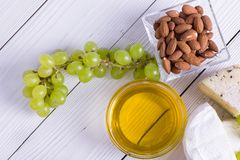 Snacks with wine - various types of cheeses, figs, nuts, honey, grapes. On a white boards background stock images