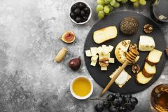 Snacks with wine - various types of cheeses, figs, nuts, honey, Stock Images