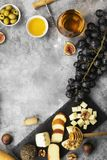 Snacks with wine - various types of cheeses, figs, nuts, honey, Royalty Free Stock Photography