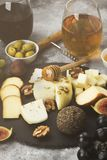 Snacks with wine - various types of cheeses, figs, nuts, honey, Royalty Free Stock Image