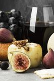 Snacks with wine - various types of cheeses, figs, nuts, honey, Royalty Free Stock Photos