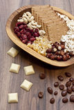 Snacks in a wood bowl. At a party Stock Images