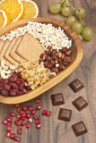 Snacks in wood bowl with fruits. Snacks on desk Stock Image