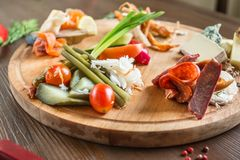 Meat platter on a wooden dish stock photography