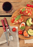 Snacks on wooden table Stock Images