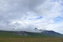 Snaefellsjokull glacier hiding behind clouds royalty free stock image