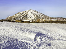 Snaekollur Mountain Kerlingarfjoll. Snow covered Rhyolite mountain with snow field in the foreground under clear blue sky stock photos