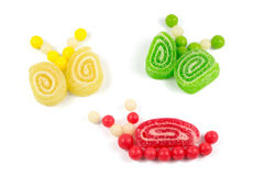 Snail and butterflies made of colorful bonbons and  jelly Stock Photo