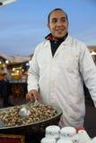 Snail food stall seller in Jemaa Al Fnaa in Marrkesh. Royalty Free Stock Images