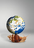 Snail with globe on shell on grey background Stock Photo