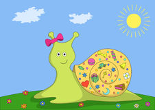 Snail on a green meadow. Smiling snail creeps on green meadow, carrying someone gifts on its bowl Stock Photo
