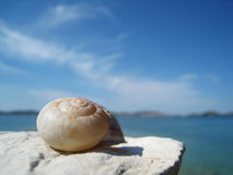 Snail house on the beach  (9). Snail house on the beach with wonderful sky and dalmatian island in background Stock Image