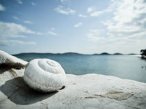 Snail house on the beach (18). Snail house on the beach, with wonderful sky and dalmatian island in background Stock Photo
