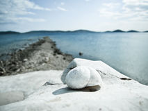 Snail house on the beach (24). Snail house on the beach with wonderful sky and dalmatian island in background Royalty Free Stock Photography
