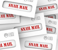 Snail Mail Envelopes Inefficient Slow Old Fashioned Message Deli. Snail Mail words in envelopes to illustrate slow, old-fashioned traditional hand delivery of Stock Photos