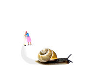 Snail making a trail. Blurred miniature cleaning lady leaning on Stock Photography