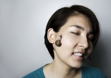 Snail massage on face of asian woman Royalty Free Stock Photos