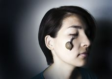 Snail massage on face of asian woman. Focus snail massage on face of asian woman in beauty secret of rejuvination theraphy Stock Photo