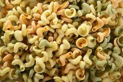 Snail shape Italian pasta texture. Twisty snail shape, Italian multicolor pasta texture, good for background stock image
