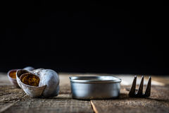 Snail shell and tin can on a wooden old table Stock Image
