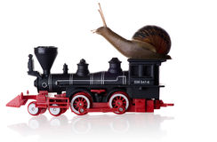 Snail sitting on a toy train Stock Photos
