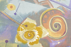Snail spyral and abstract flower on colorful fabric. Royalty Free Stock Photos