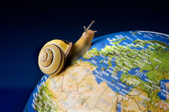 Snail tourist. Garden snail travelling around the world like a tourist Royalty Free Stock Photography