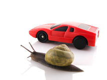 Snail versus sports car. Competition between a snail and a sports car Royalty Free Stock Images