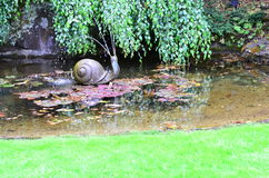 Snail water fountain Stock Photos