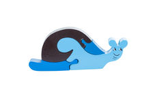 Snail wooden puzzle over white background royalty free stock photography