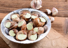 Snails with garlic butter Royalty Free Stock Images