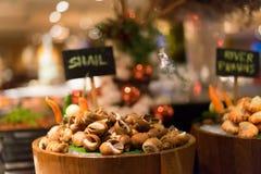 Snails grill stock photos