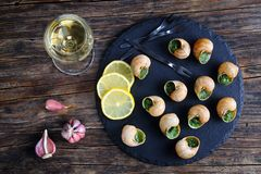 Snails with herbs butter garlic, top view Stock Photo