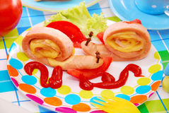 Snails made from sausage and cheese for child Stock Photos