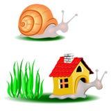 Snails move house. Snail climbs carry boxy playhouse Stock Photos
