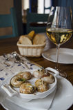 Snails prepared by the cook at restaurant. ! Royalty Free Stock Photography