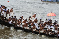 Snake Boat Race. People in traditional dress rowing the snake boats in Aranmula boat race in Kerala, India Stock Photo